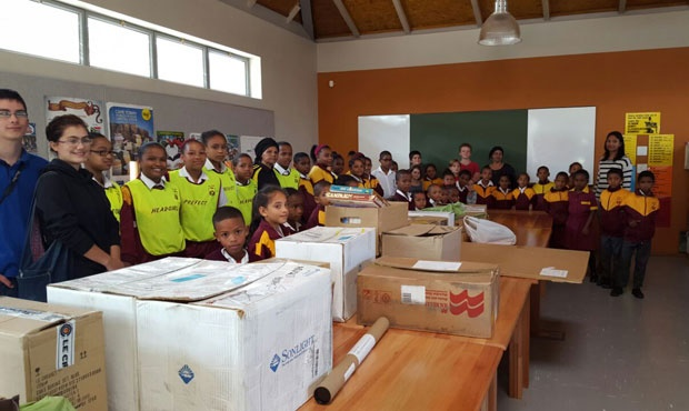 Learner's from Red River Primary School, Manenberg with their donation of books from around the world