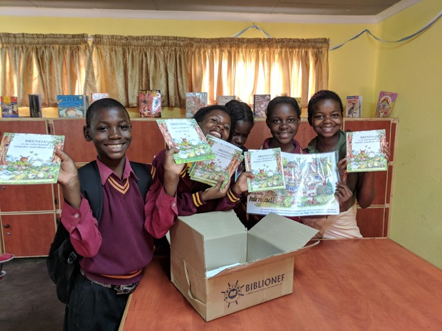 Beneficiaries with their donation of Brenda books for World Aids Day